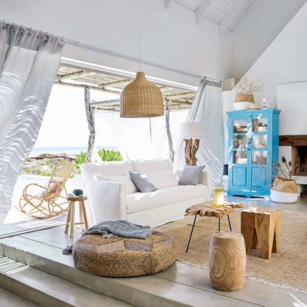 Coastal cottage living area with pure bright schemes outlooking vast sea view giving a complete beach style home Image 25